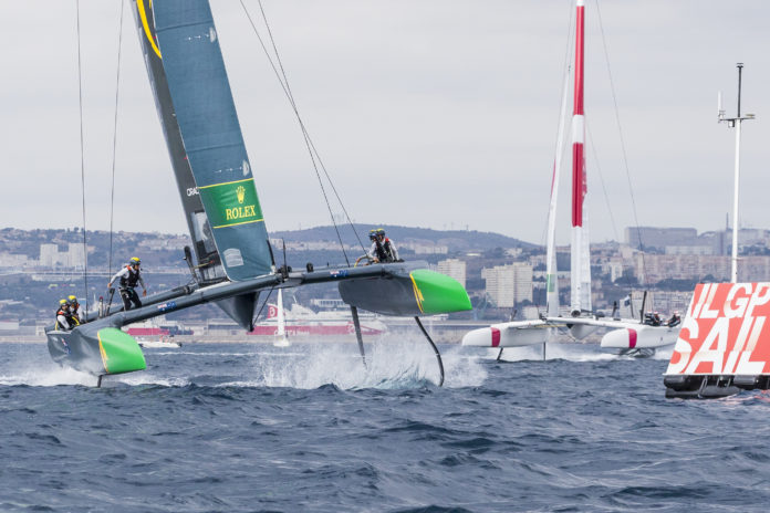 Australia SailGP Team skippered by Tom Slingsby cross the finish line to win the Match Race and SailGP Season 01 Championship on Race Day 3.