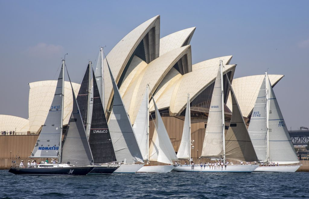 Sparkman & Stephens designed yachts that will be competing in this years 75th Rolex Sydmey Hobart Yacht Race, sail in formation on Sydney Harbour. From left is Komatsu Azzurro, Galaxy III, Love & War, Windrose, Eve, and Kialoa II. 7th December 2019. Photograph Dallas Kilponen.
